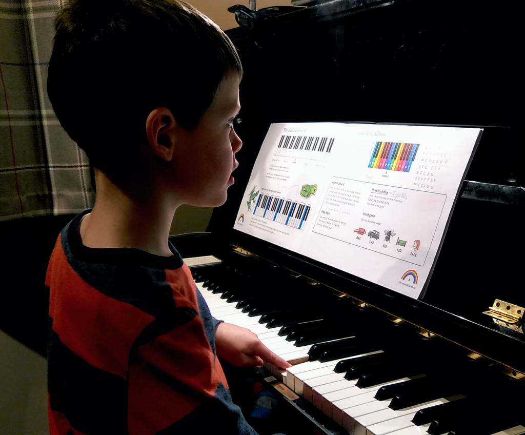5 year old child playing piano